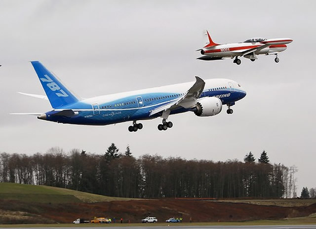 787 takes off with chase planes on its first flight