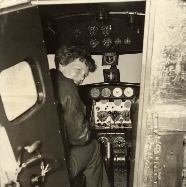 Amelia Earhart in the cockpit of her Lockheed L-10 Airplane