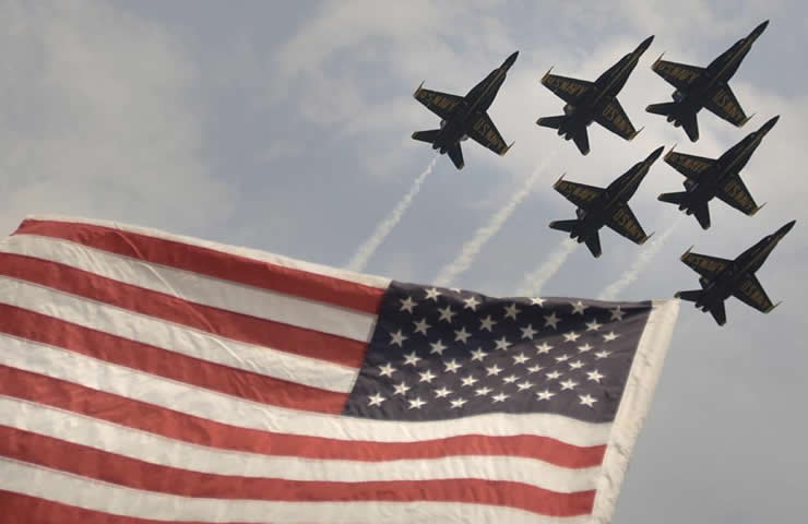 blue angels flying in formation over the american flag