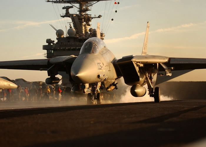 f14 tomcat takes off from aircraft carrier