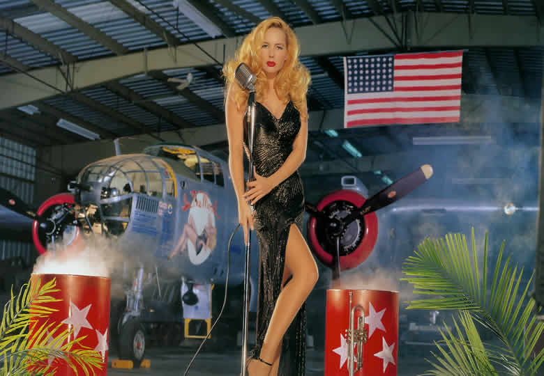 beautiful female model with a B-25 Aircraft