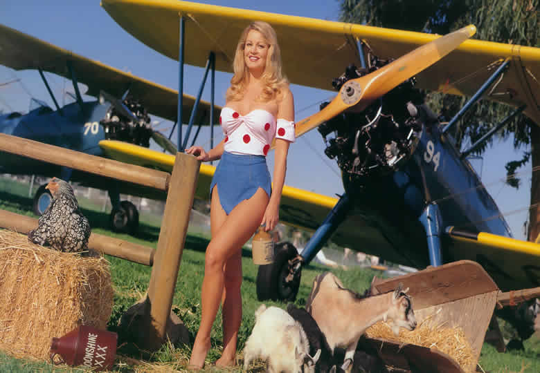 Gretchen Stockdale with an old boeing N2S3 single engine aircraft