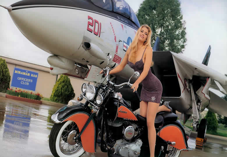 Catherine Milulicich with an F-14 Tomcat Naval Aircraft
