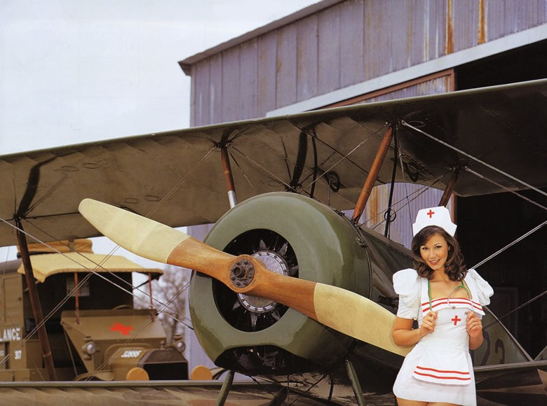 beautiful nurse with a propeller plane
