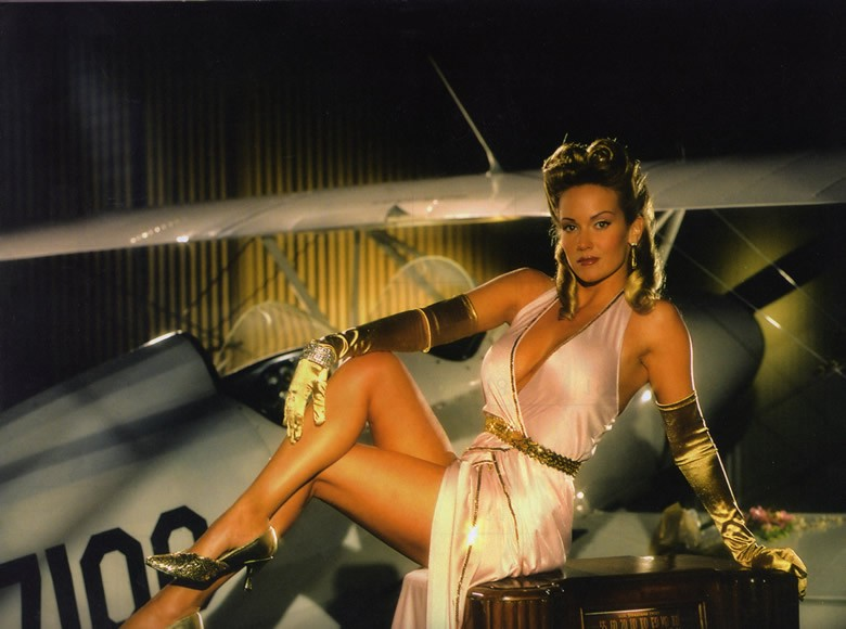 classy female model with prop plane