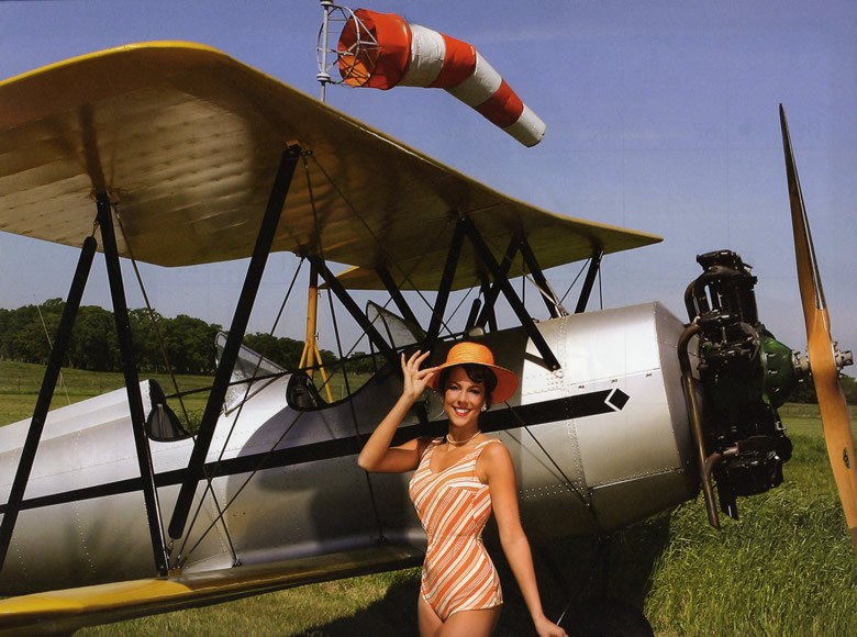 pretty girl with ww2 airplane