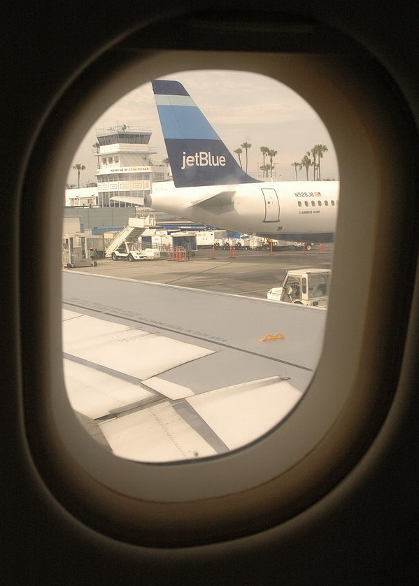looking out the window on a jetblue airbus a320 airplane