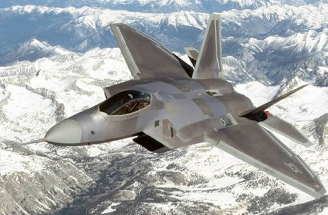 F22 flying over mountains