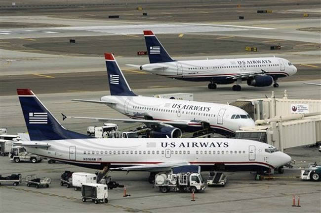 us airways aircraft at airport gate - boeing 737 and airbus a320