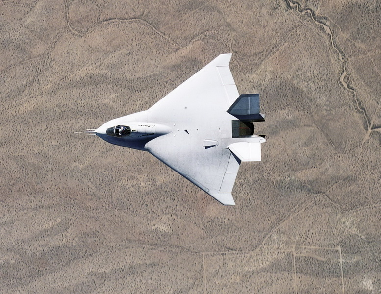 boeing x-32 in flight over desert