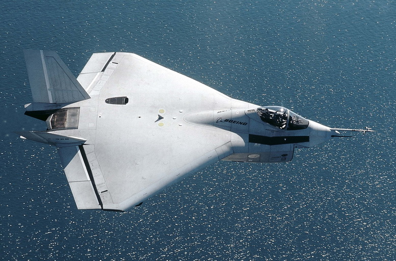 boeing x-32 flying over ocean
