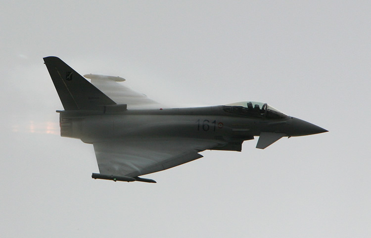 rafale flying in the clouds
