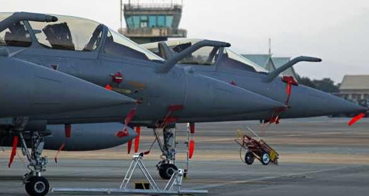 3 rafale jet fighters on the tarmac in france