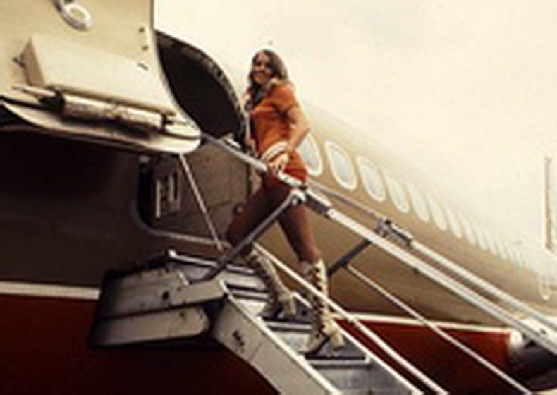 flight attendant walking up stairs from southwest airlines