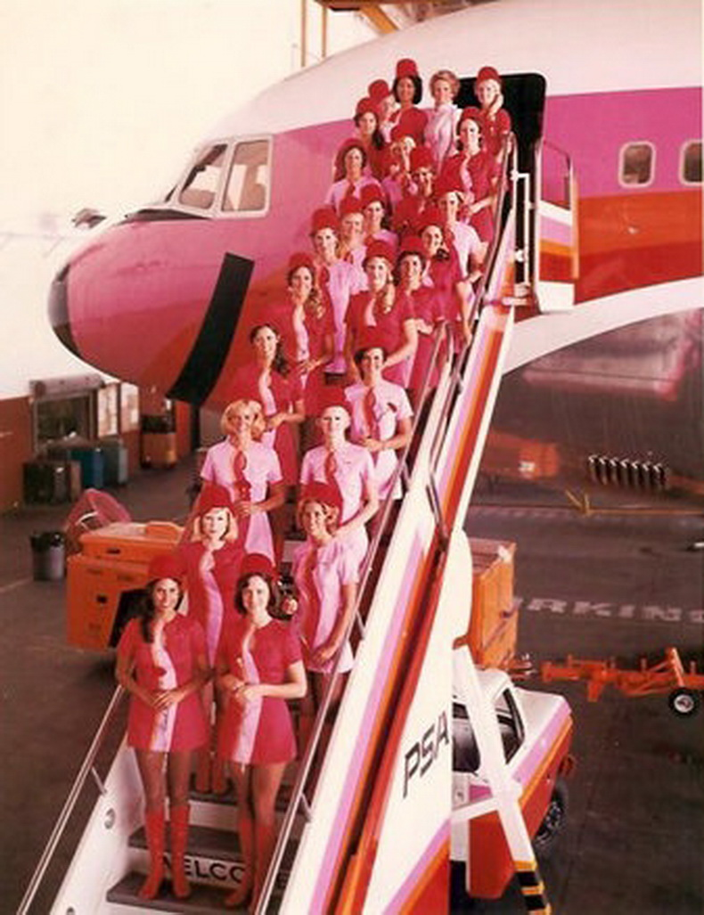 flight attendants from psa airlines standing on air stairs of L-1011