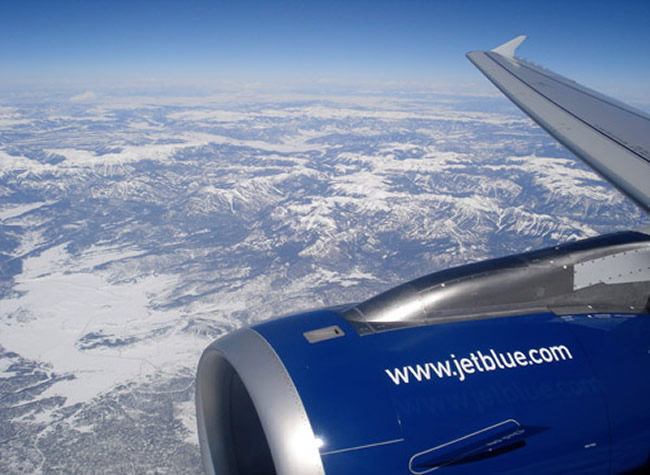 Looking out the window flying in a Jetblue A320 Aircraft